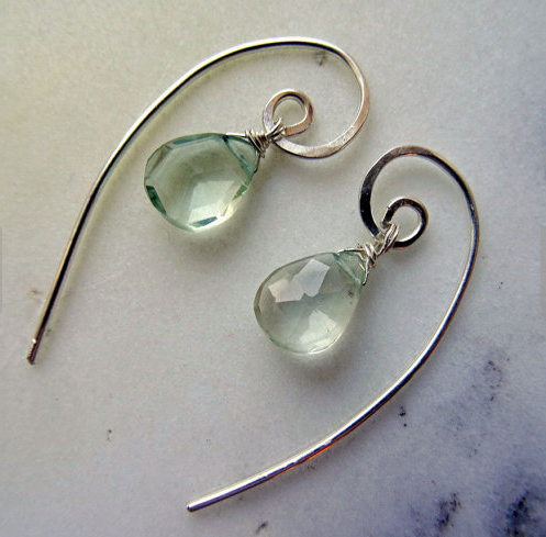 """The Prasiolite earrings are artisan-made in the United Kingdom. Each pair is similar design-wise but unique because of """"Mother Nature's fingerprints"""" on the gemstones.  According to the Etsy shop, Prasiolite is said to clear negativity, foster compassion, acceptance and self-esteem, ignite love and compassion in one's heart, heal by connecting the physical and spiritual, attract prosperity, bring good fortune, strengthen the emotions and mind the will."""