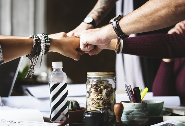 a-team-fist-bumping-as-they-share-the-workload
