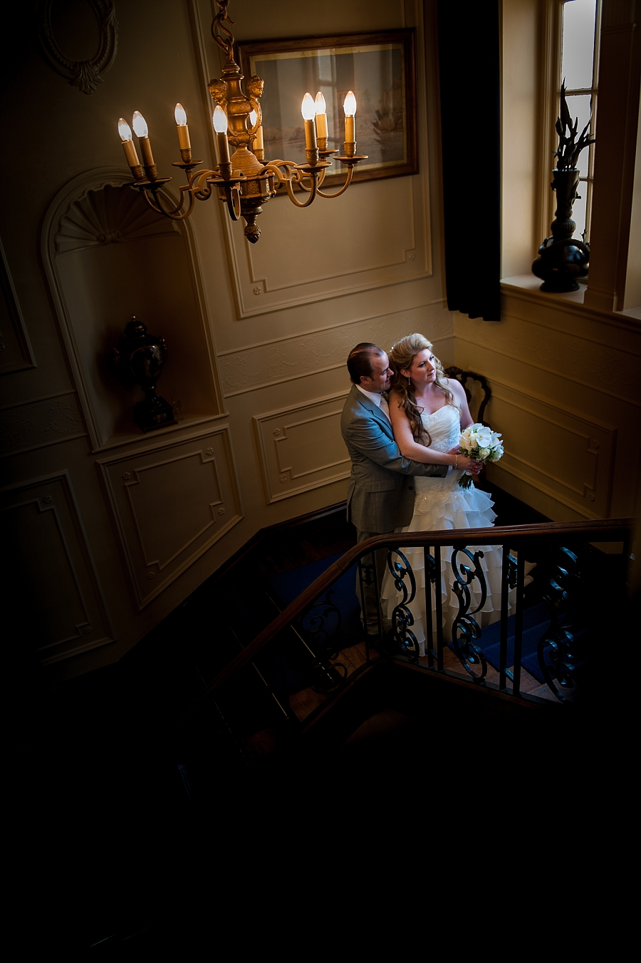 Bride and groom on the stairway at The Lawn in Rochford, Essex