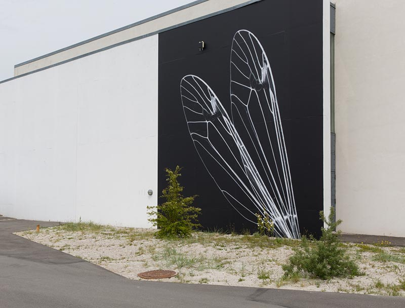 Nanna Debois Buhl, intervals and forms of stones of stars, 2017, wall photographs mounted on the facade of Arken Museum of Modern Art, Denmark