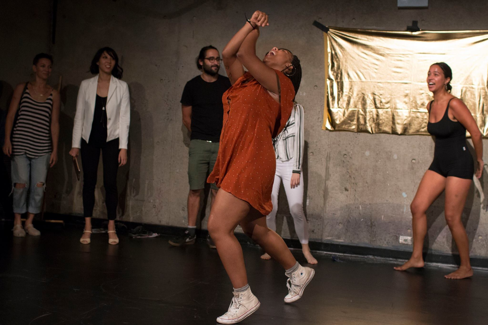 """In Part II the audience was invited to take part in the The (Im)Migrant Hustle dance line, inspired by Soul Train. Each person was invited to contribute a dance move that represented their family's relationship with migration, whether by choice/ force/ necessity or indigeniety, and finding """"respectability"""" in the USA."""