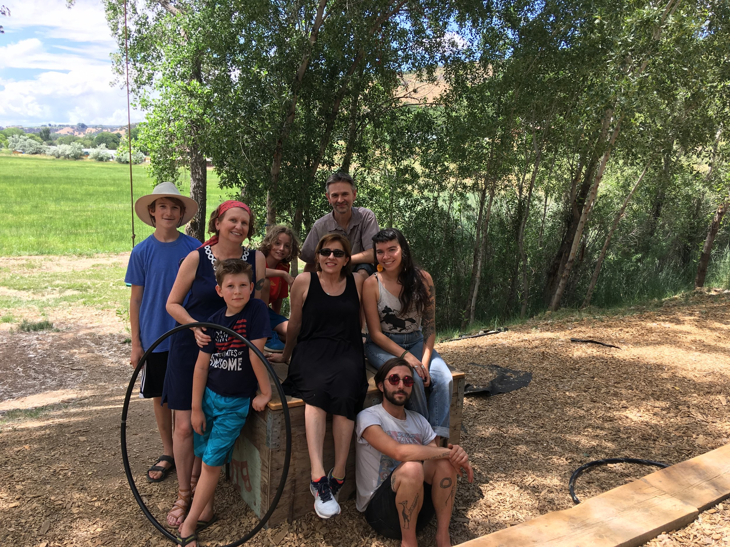Resident Ginny Kaczmarek with her family: Ian, Emery, and Adrian, and Resident Maria Velasco with her son Alex. Sitting with Program Manager Henry Kunkel and Director Carolina Porras after a Sunday brunch at Delicious Orchards, a morning shared with tasty food, swings and hula hoops.