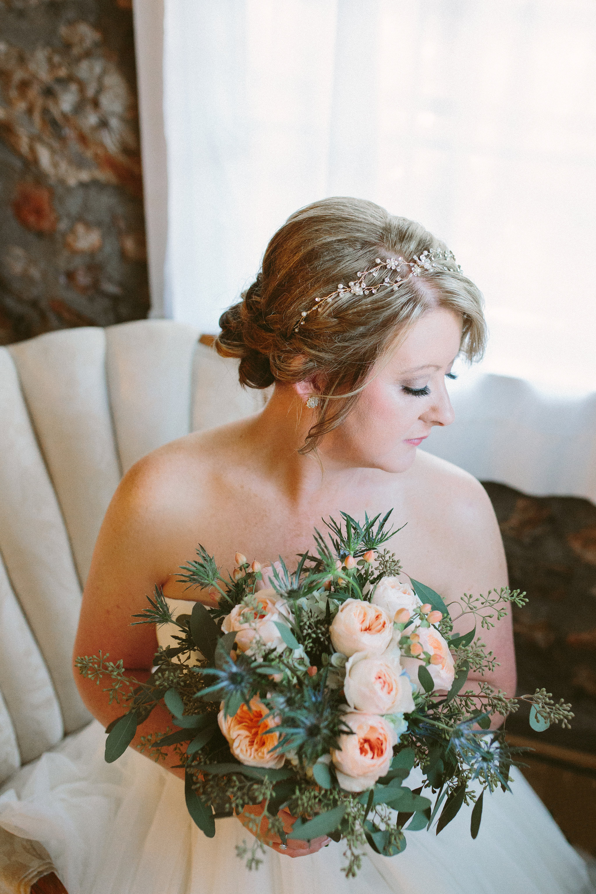 Melissa was an absolutely gorgeous bride. I loved her bouquet filled with antique blush roses and thistle.