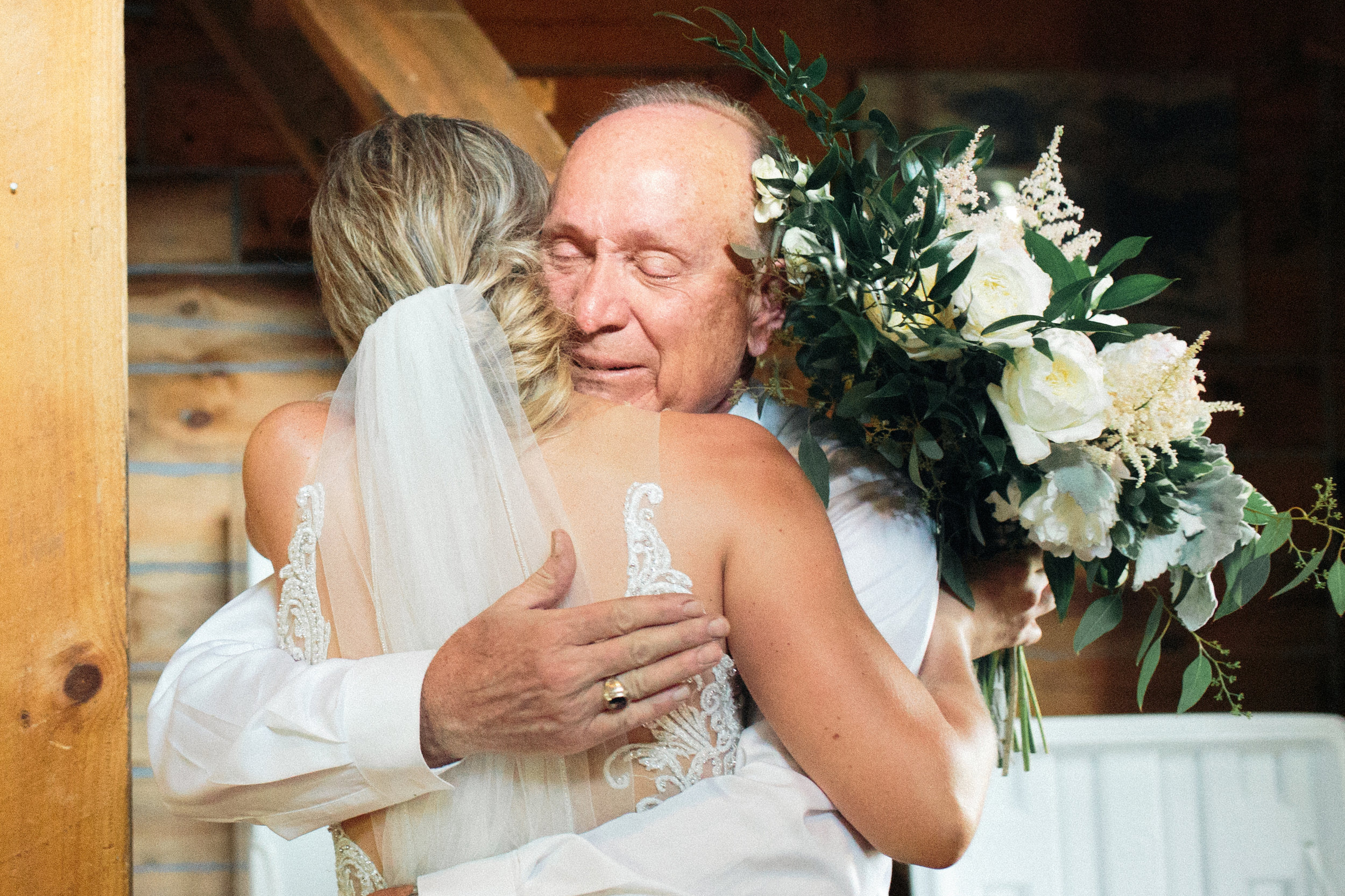 dad hugging daughter on her wedding day