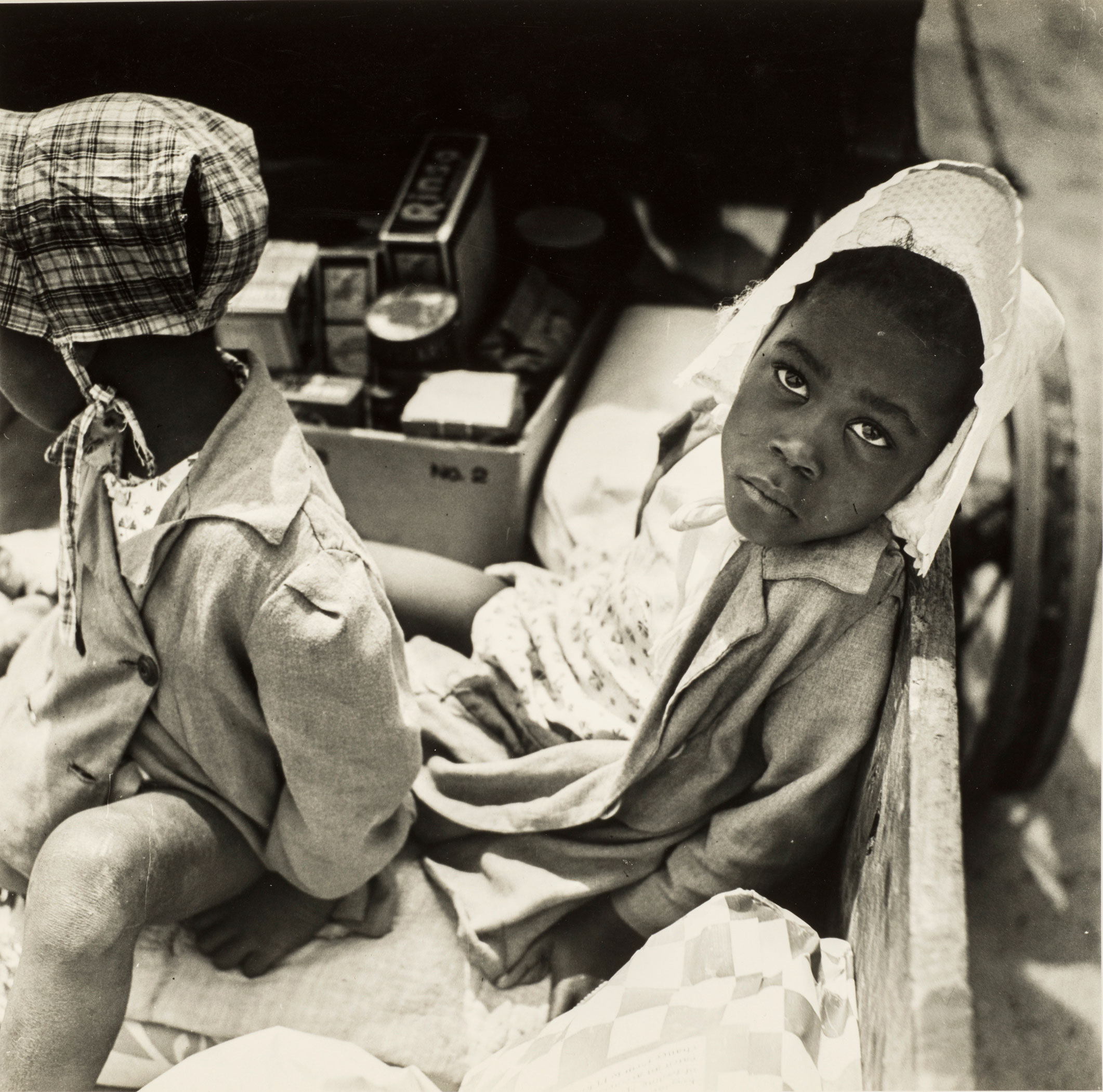 Esther Bubley,Children waiting for their mother to finish shopping, 1945; Gelatin silver print, 11 x 14 in.; Gift of Robert and Kathi Steinke; © Standard Oil (New Jersey) Collection #26162; Photographic Archives, University of Louisville; Photograph by Lee Stalsworth