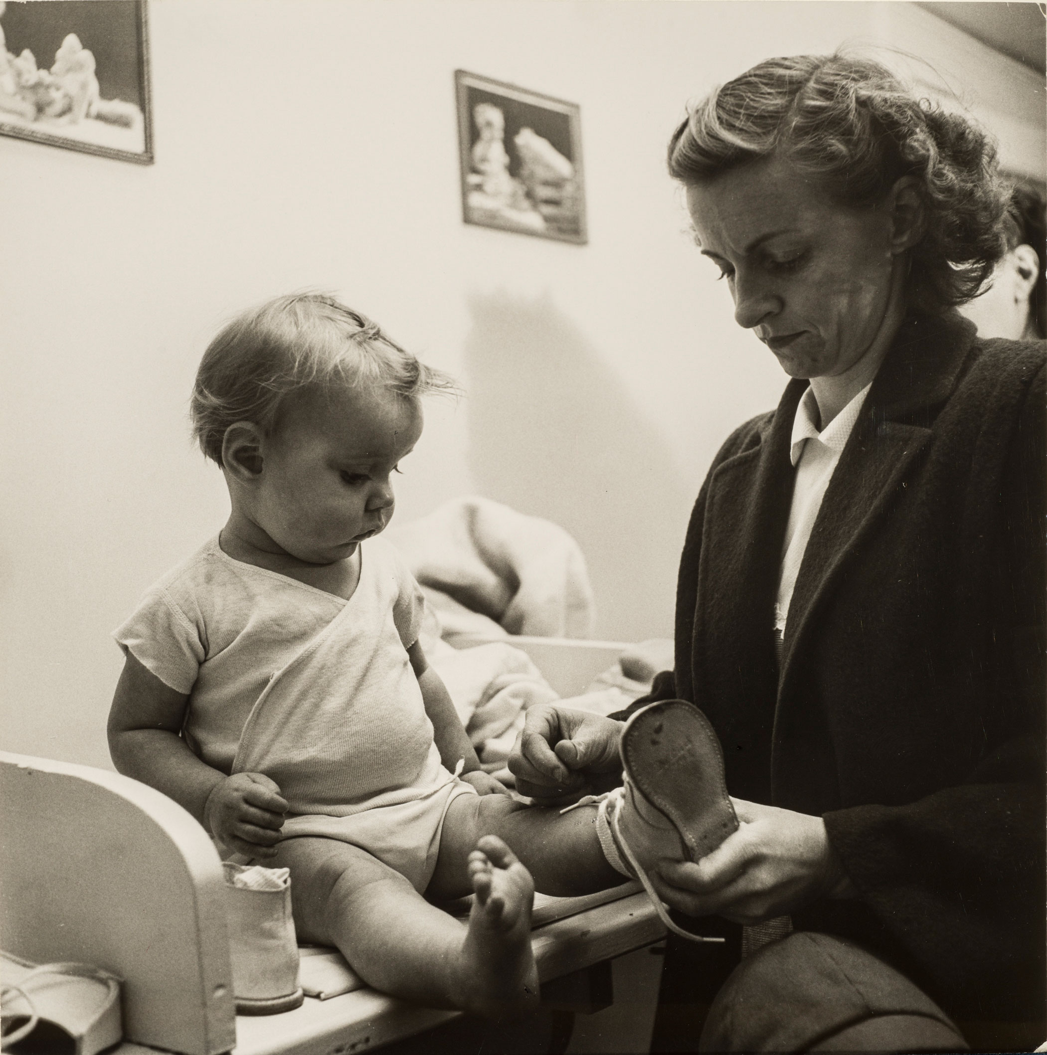 Esther Bubley,At the well-baby clinic, 1953; Gelatin silver print, 7 5/8 x 7 1/2 in.; Gift of Kenneth and Lori Polin and Family; © Standard Oil (New Jersey) Collection #76624; Photographic Archives, University of Louisville; Photograph by Lee Stalsworth