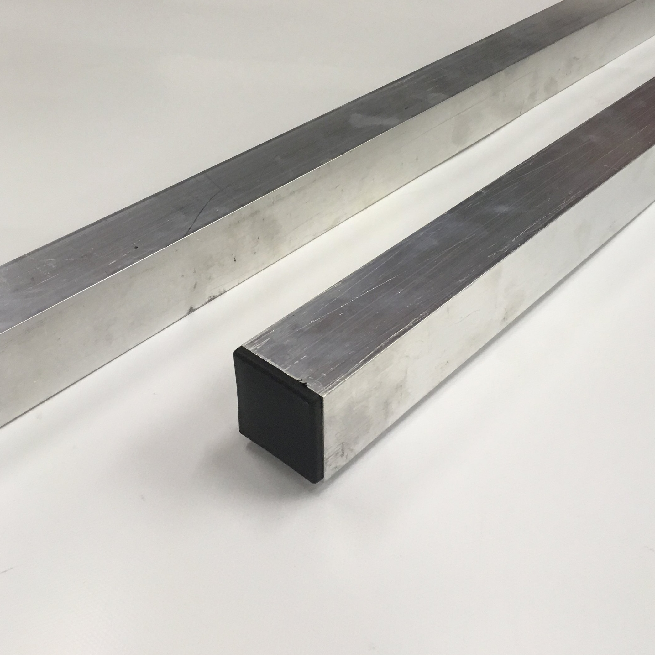 """2"""" Aluminum Spacer $84.20   Two 8ft 2x2 aluminum square tubes."""