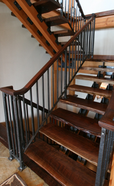 All metal components for this walnut staircase were hand forged with a natural oil finish.