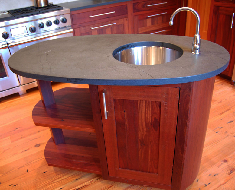Reclaimed Jarrah with soapstone top.