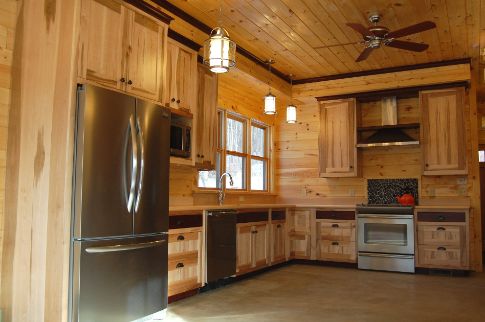 David & Sara's custom kitchen incorporated maple with dark accents banding from the drawers to the ceiling.