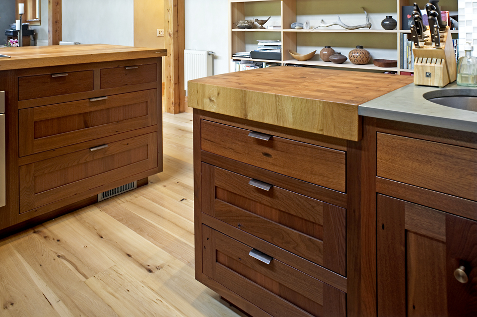 Walnut cabinet drawers are topped with a custom hardwood chop block.