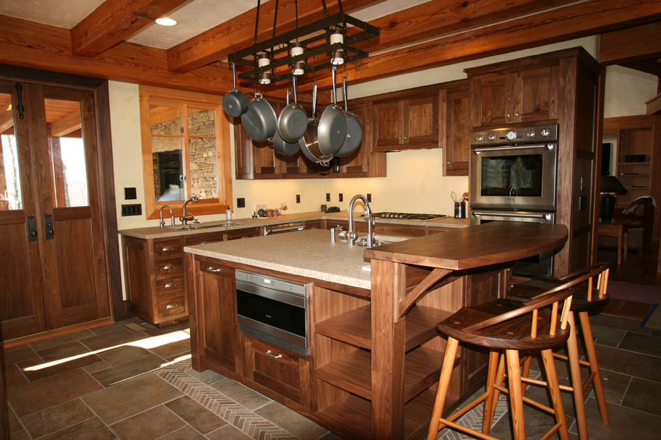 A large central kitchen island crafted of FSC Certified walnut.