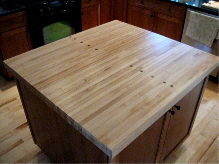 An old bowling alley salvaged by Pioneer Millworks finds new life as the island top for a family kitchen in upstate NY.