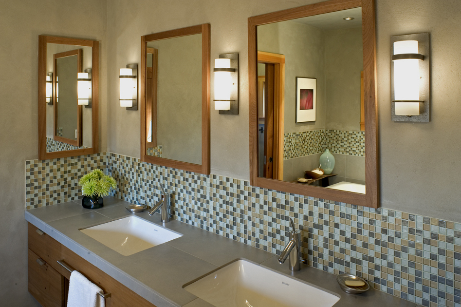 Natural slate from Sheldon Slate is joined to create the double sink bath vanity topping custom walnut cabinetry.