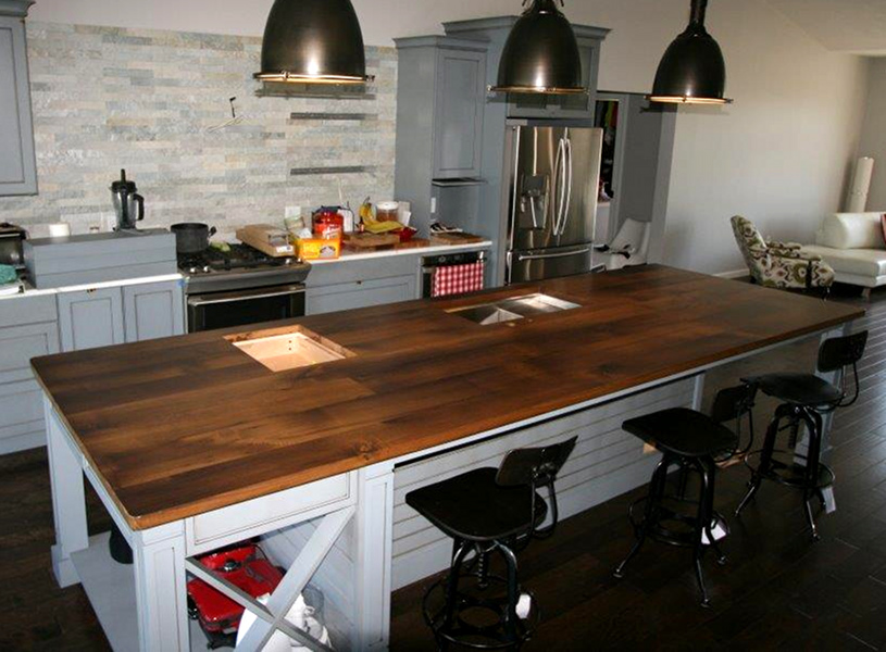 """This top was crafted of reclaimed Chestnut and includes a sink and cut-out """"window"""" into the mini fridge."""
