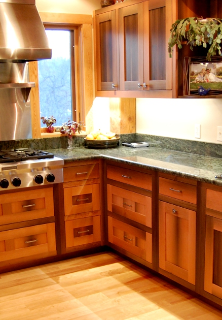 granite_counter_river_fir_cabinets.jpg