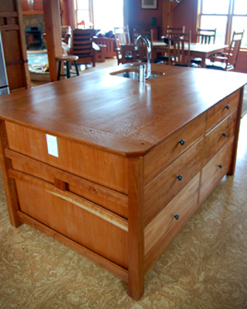 Mission style, custom wood kitchen island features a wood top with built-in sink.