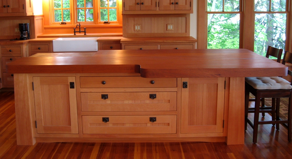Several inches thick, this wood countertop curves to allow room for more seating and easier access to cabinets.