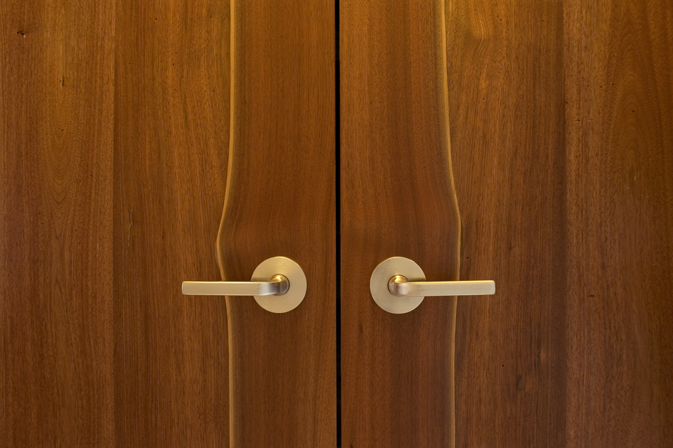 These doors are crafted from reclaimed walnut. The stiles were left with natural live edges therefore allowing the contrasting sap wood to show and create and more natural feel. D18