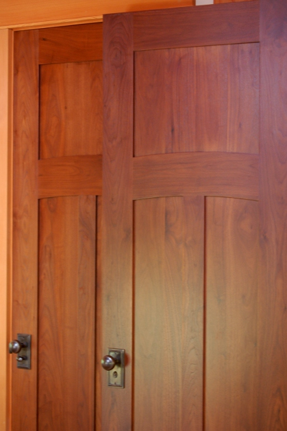 Matching walnut interior doors. D52