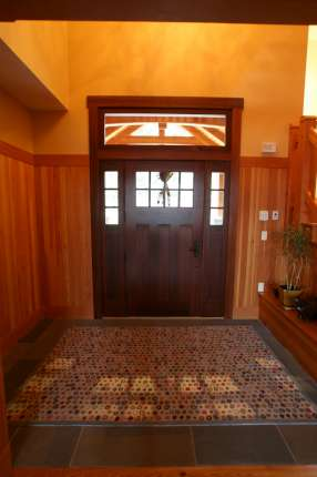 Interior of custom door featuring side lights and transom window. D53