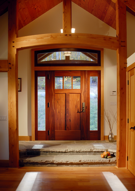 Reclaimed Jarrah front door with large sidelights and transom greets visitors to this Catskill Mountains lakeside home. D10