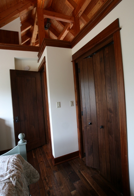 Interior doors, including bi-fold closet doors, were crafted from Eastern Walnut for this timber frame home.