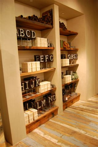 Display shelving crafted of reclaimed pickle vat stock. F5
