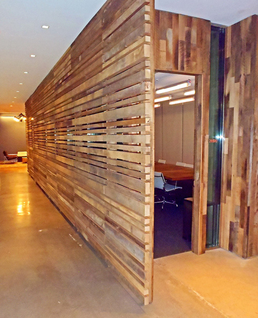 "Reclaimed hardwoods ""wall"" divides space in an advertising agency. F14"