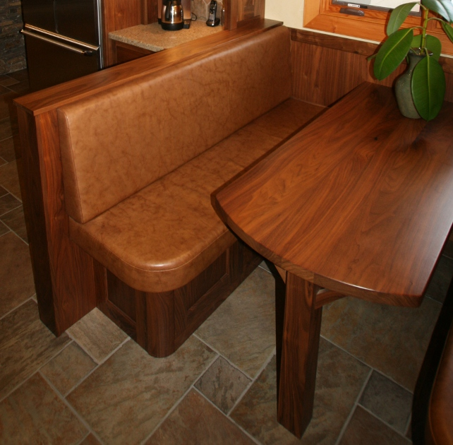 Walnut booth seating and table in breakfast nook.