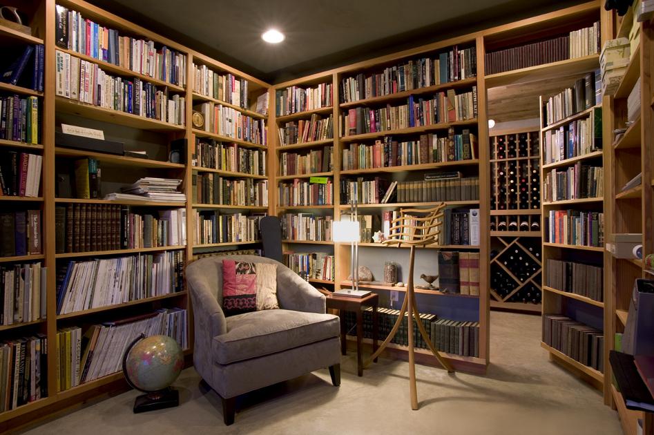 This wine cellar is found hidden behind a book case. W3