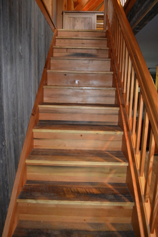 Stairs crafted of reclaimed Settlers' Plank wood.