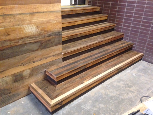 Reclaimed Settlers' Plank Mixed Hardwoods stairs and siding.