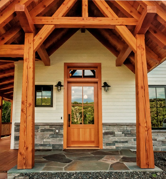 The entry to this family home greets visitors with a custom Douglas fir door which accommodates the needs of a handicapped child while allowing abundant light into the home. D4