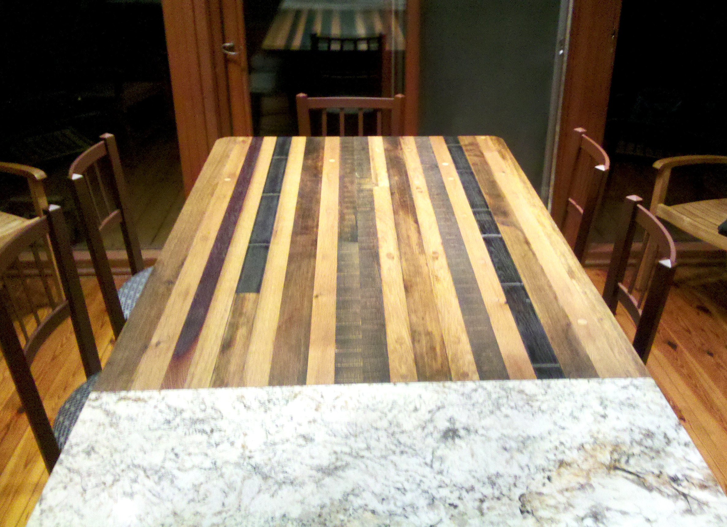 Old French white oak and domestic barrel/vat stave were repurposed into a dining table for Mathew's family meals.
