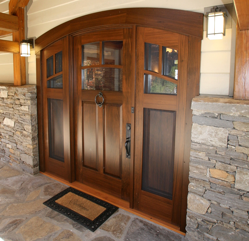 This mountain home entry door features two 'layers' of sidelight, ones with screens on the exterior and the others with glass on the inteior (which swing open to let air thru the screens). D17