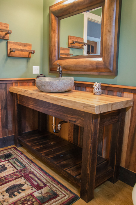 """Powder room vanity topped with a large slab of reclaimed elm sitting on """"toasted"""" reclaimed oak base."""