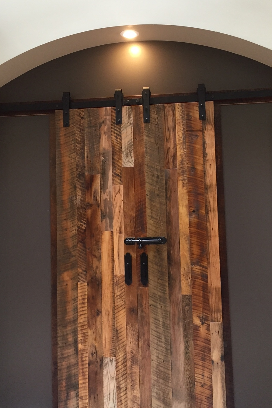 Flat Track Door with Settlers' Plank Mixed Hardwoods for a retail location.