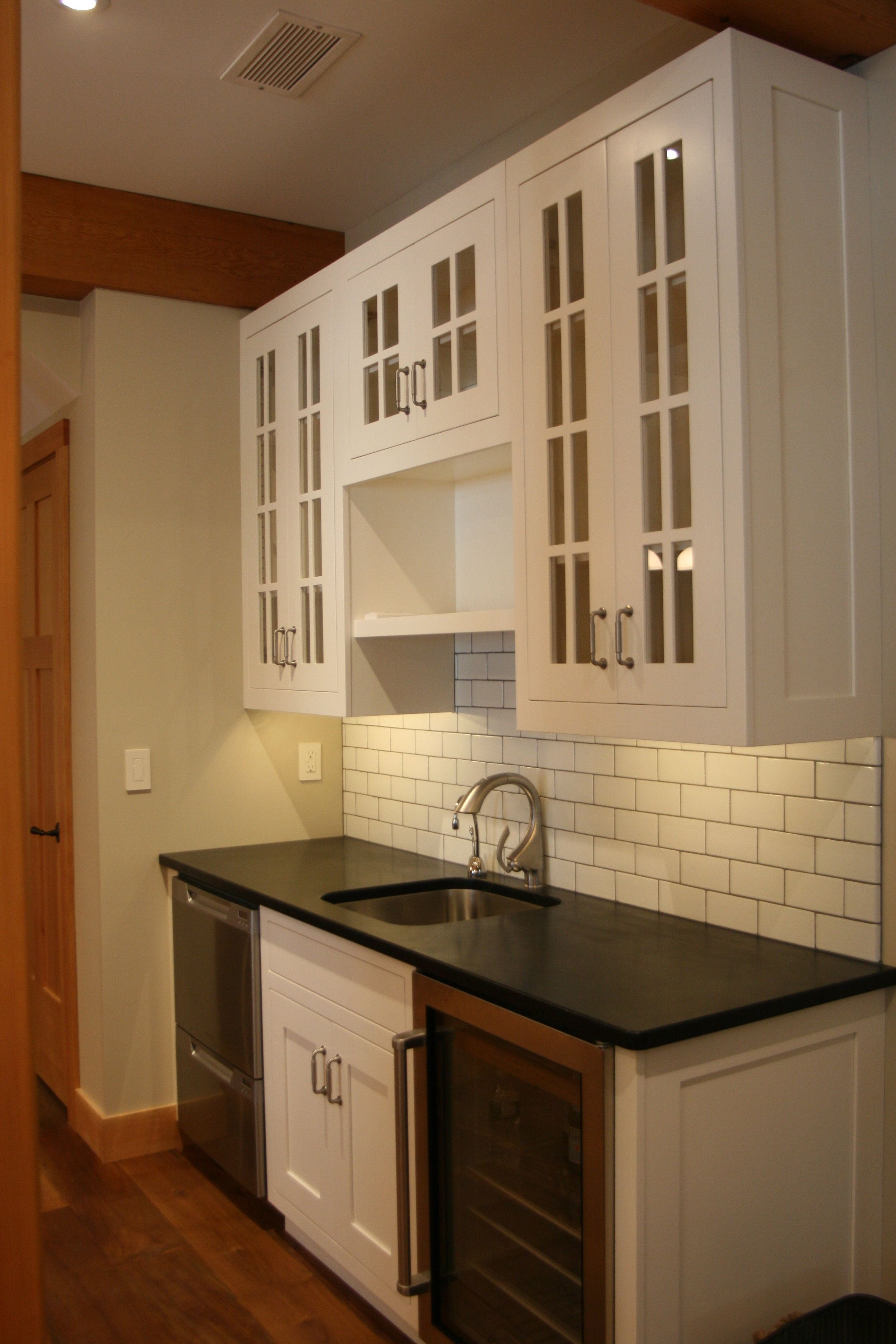 Custom finish Maple kitchenette with soapstone counter top
