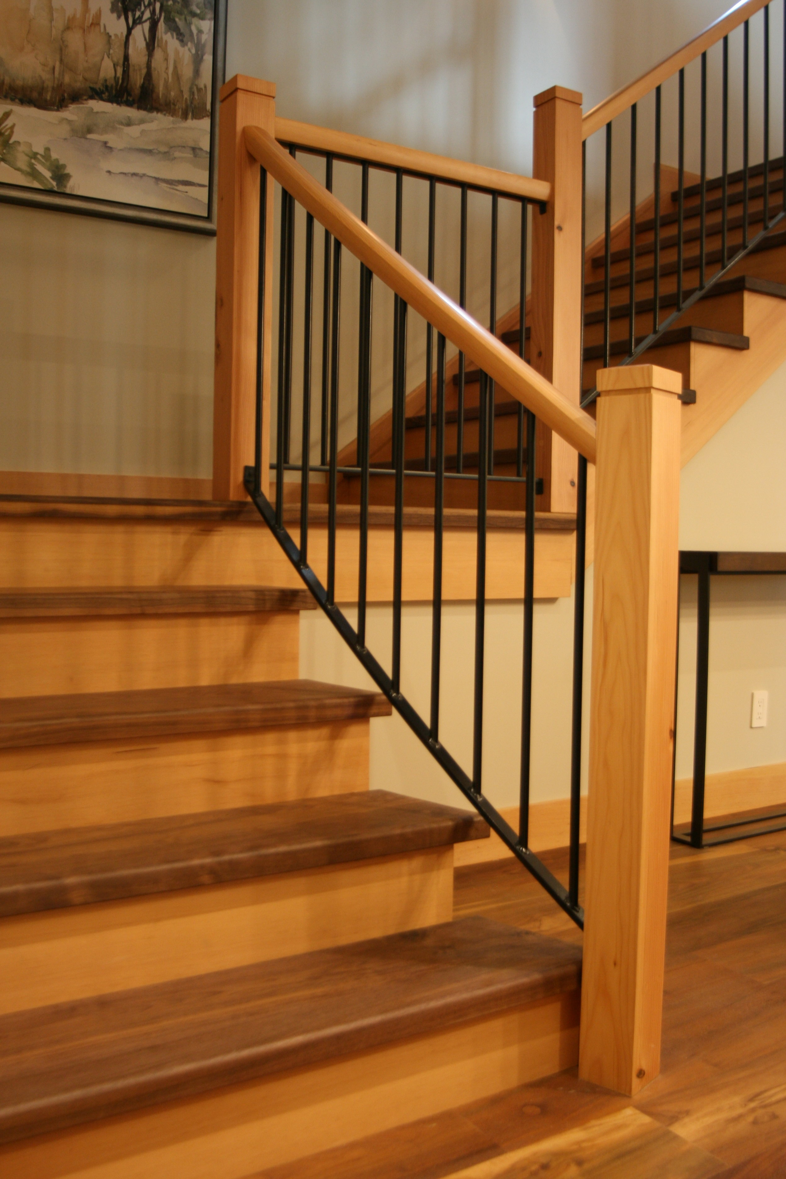 Stairs have Walnut treads, custom metal stringers, Douglas Fir newels and hand rail