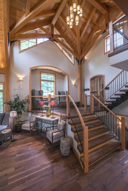 Walnut stair treads, custom metal stringers, Douglas Fir newels and hand rails. Photo © Scott Hemenway