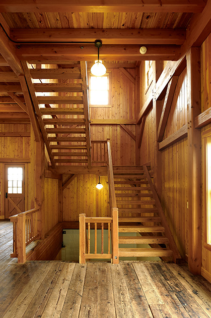 Custom stairs inside large timber frame barn in Poolsville, MD.