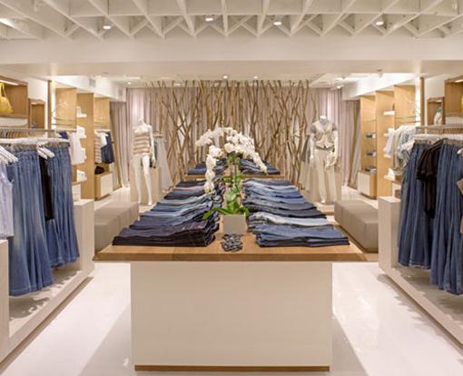 Oak shelving and tabletops inside clothing store