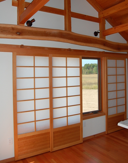 Shoji inspired screen flat track doors give a master bedroom privacy or slide aside to reveal panoramic views.