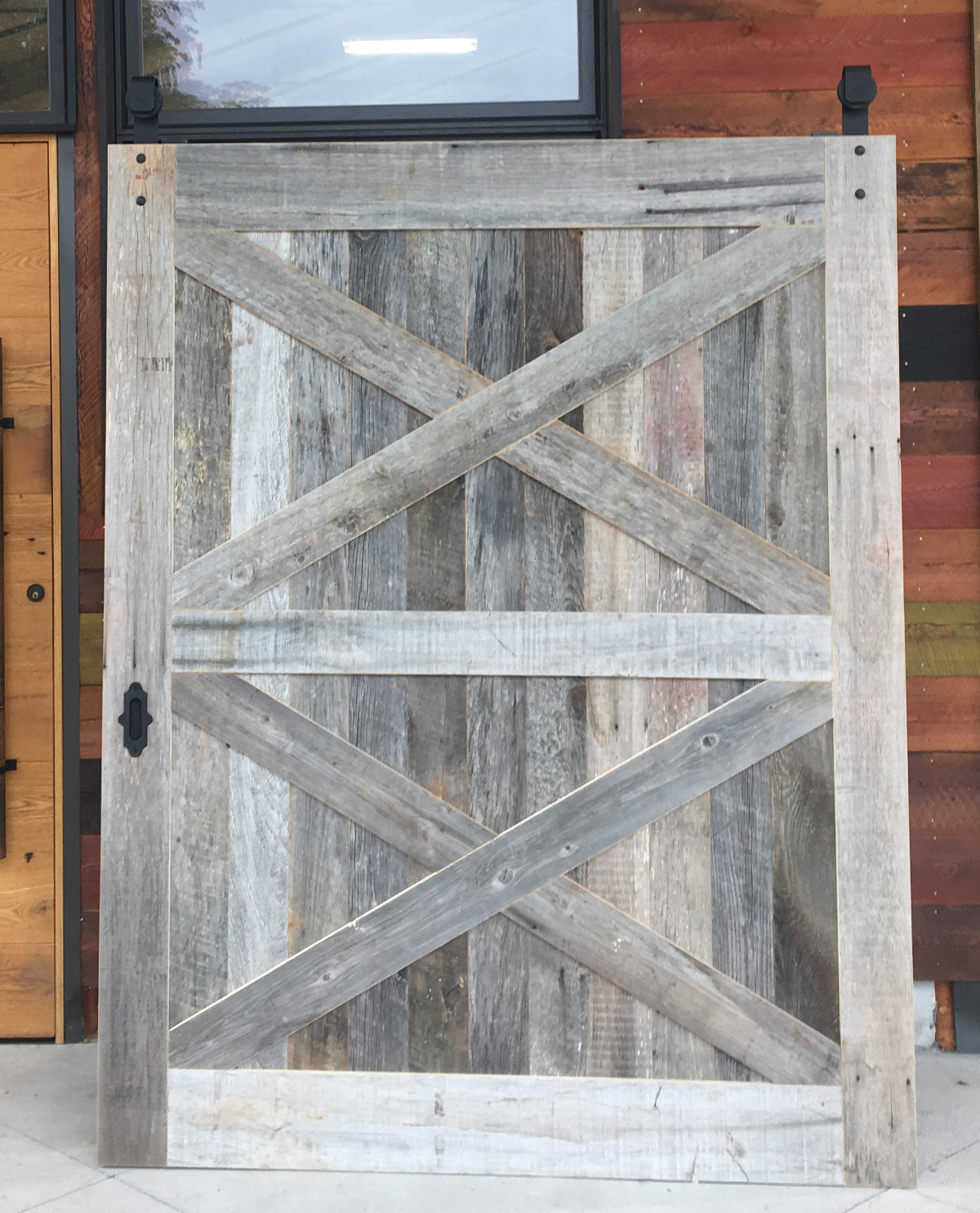 A wide Reclaimed American Prairie Mixed Softwoods weathered plank door.