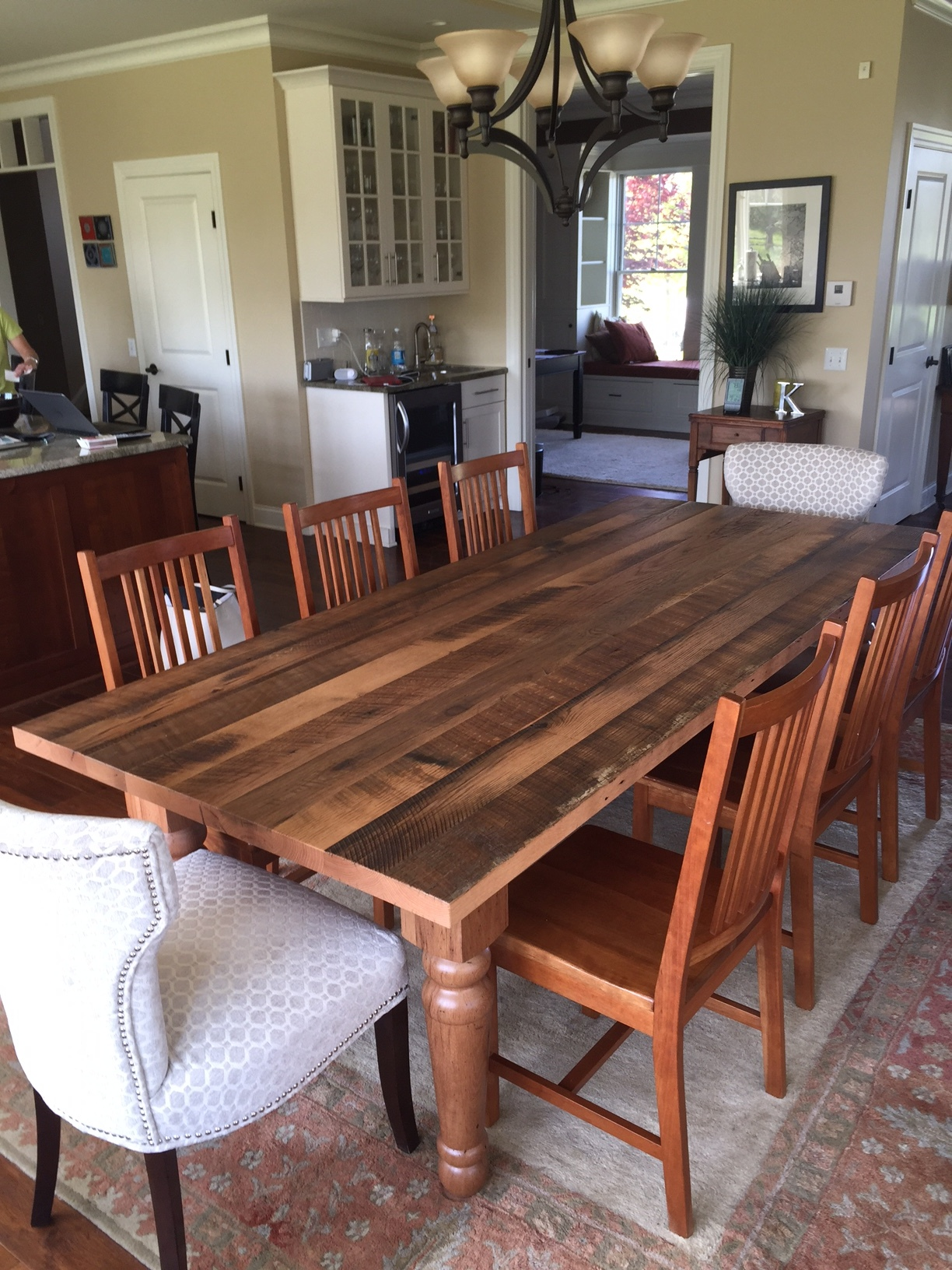 Farmhouse style dining table with reclaimed table top
