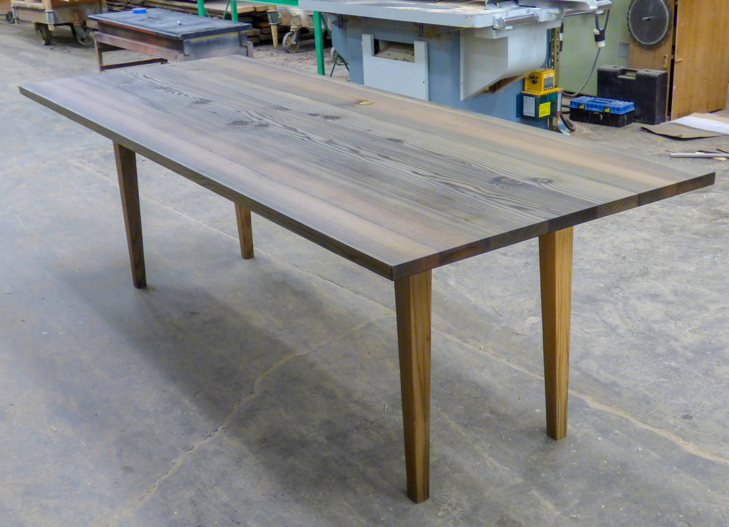 Dining room table made of reclaimed river fir