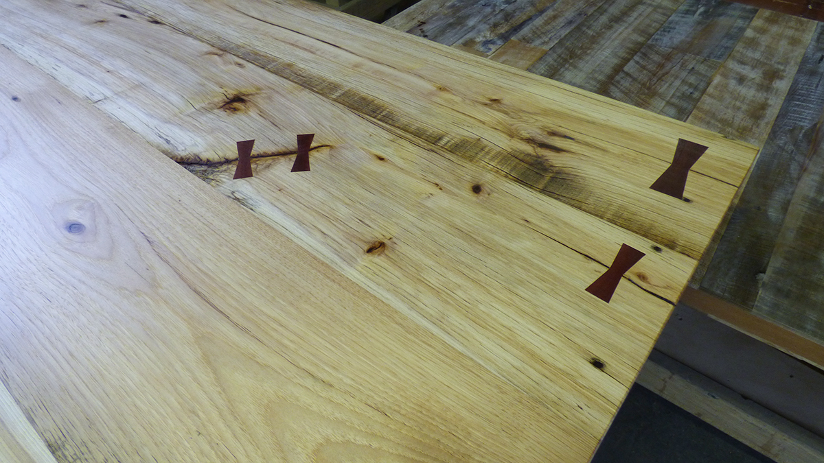 Reclaimed hickory table with contrasting butterflies.