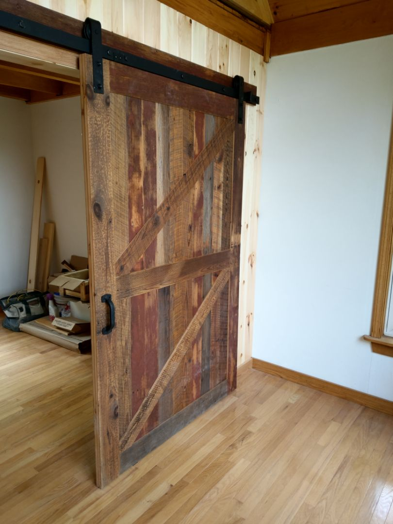 Flat Track Door-Reclaimed Softwoords with Occasional Original Red Paint Left In Tact
