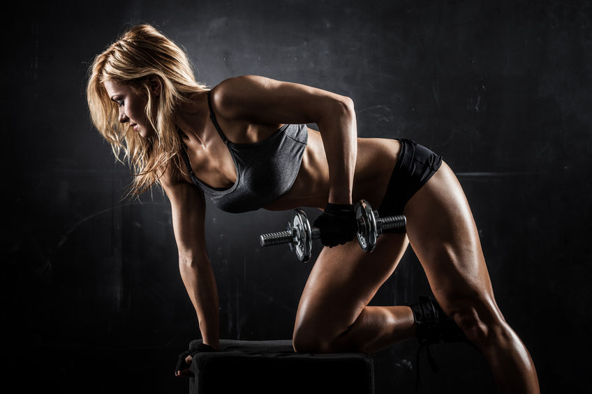 Young woman lifting weights - Ultimate Health - Studio City Personal Trainer Hollywood, CA
